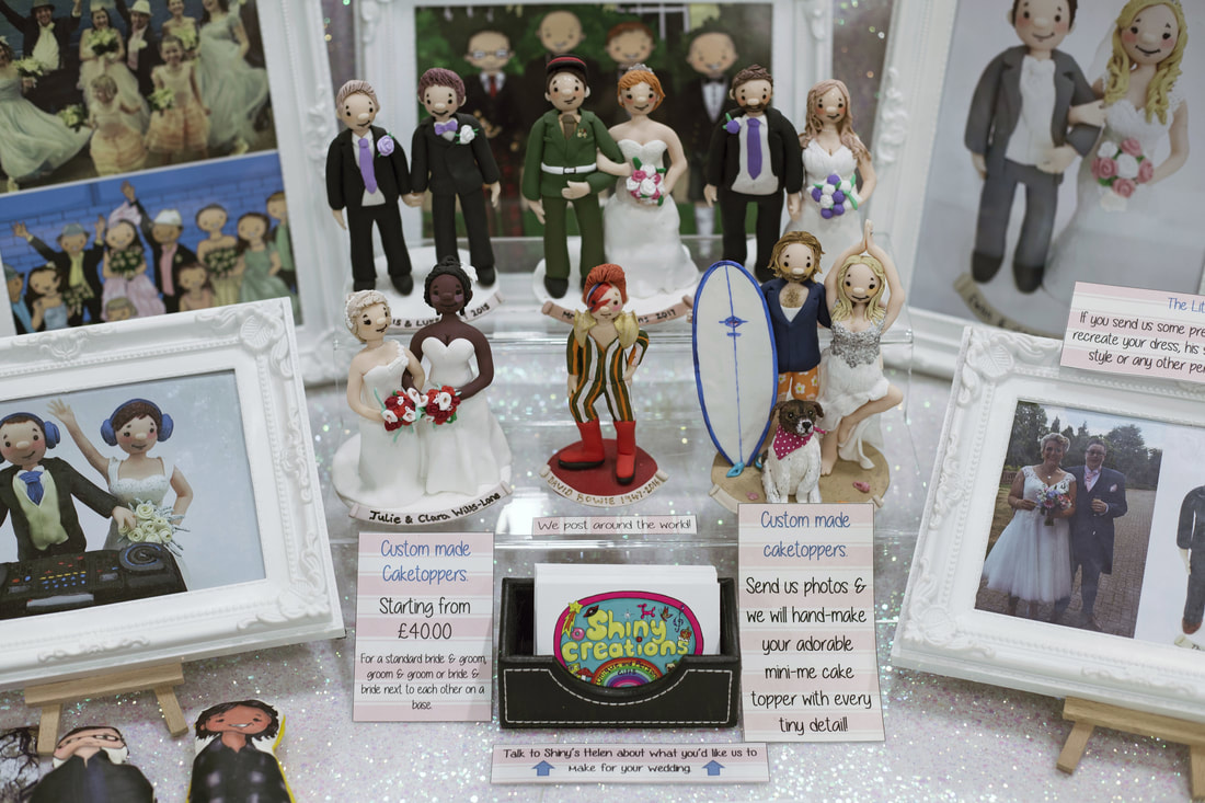 Shiny Creations custom cake toppers at the Wight Bridal Wedding Show, October 2017. Should I bother going to a Wedding Show? - Holly Cade, UK Wedding & Portrait Photographer, based on the Isle of Wight.