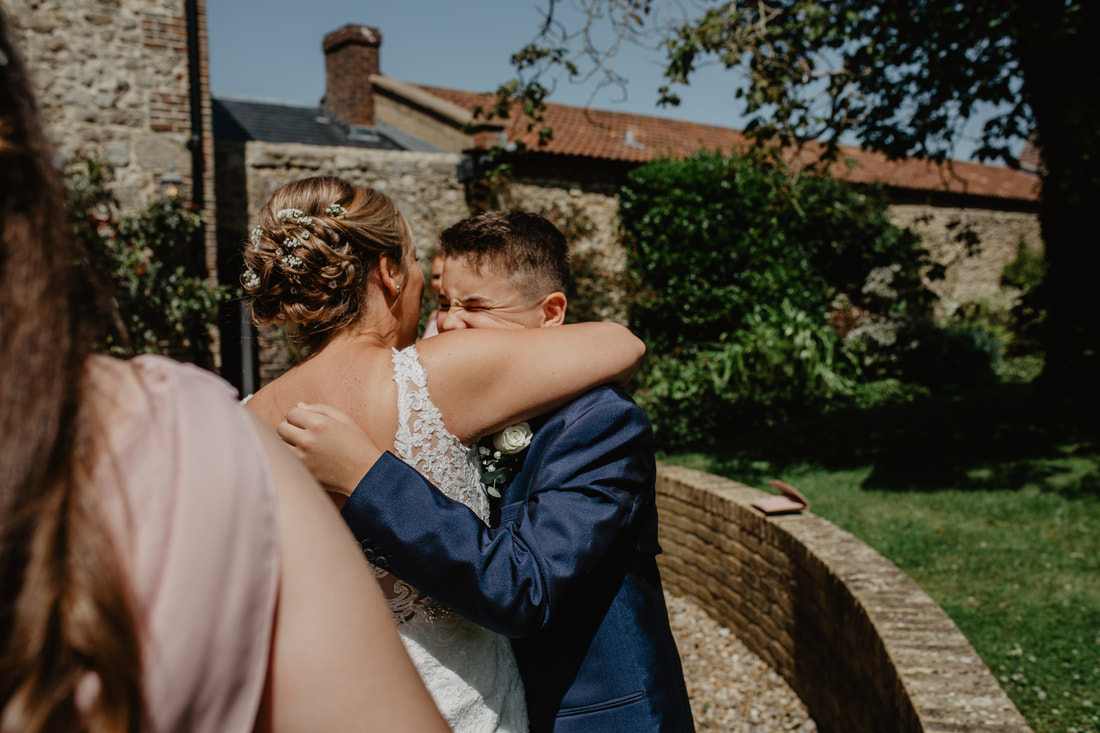 Charlotte & Phil's summer wedding at East Afton Farmhouse, Isle of Wight : Holly Cade - Alternative Candid Documentary Wedding & Portrait Photographer. Available to shoot on the Isle of Wight, Portsmouth, Southampton, Hampshire, the South Coast of England, throughout the UK and Worldwide.